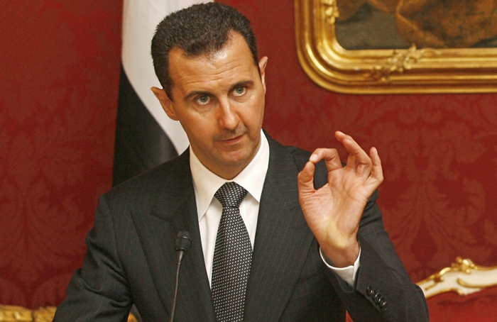 Syrian President Bashar al-Assad gives a press conference after his meeting with his Austrian counterpart Heinz Fischer on April 27, 2009 in Vienna at the start of his two-day state visit. AFP PHOTO / DIETER NAGL (Photo credit should read DIETER NAGL/AFP/Getty Images)